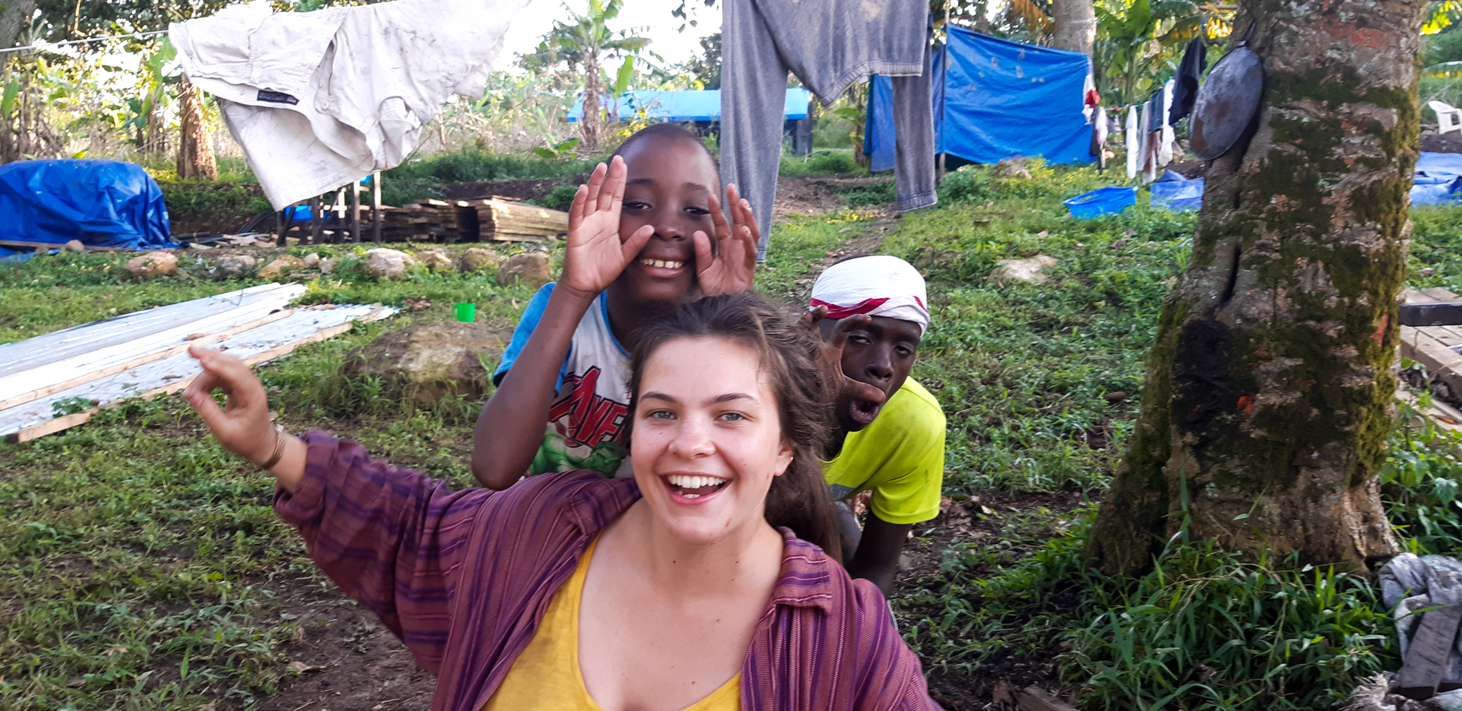 Charlotte Wager with children at Firefly Uganda